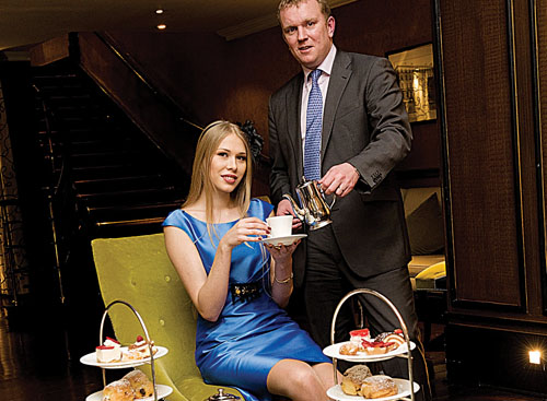 Cian O Broin, General Manager of Hotel Meyrick ensures this model gets her coffee fix in advance of the night of fashion at The Meyrick.