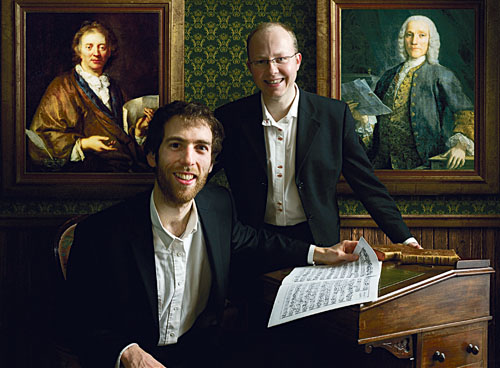 Julien Wolfs and Pawel Siwczak accompanied by portraits of François Couperin (left) and Domenico Scarlatti.