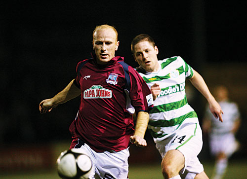 Galway United's Thomas Heary beats Graham Barrett of Shamrock Rovers to the ball in action from the Airtricity League game in Terryland Park on Friday night. 					Photo:-Mike Shaughnessy