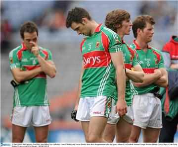 Time for reflection: Ger Cafferkey, Alan Dillon, Liam O'Malley and Trevor Howley reflect on what might have been after the final whistle. Photo:Sportsfile