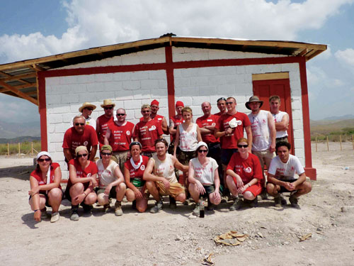 Flying the flag for the county in front of the Galway house in Haiti is most of the Galway team who were part of a group of 297 volunteers who built 63 homes, a community centre, and a children's playground in an-earthquake-ravaged area called Gonaives. They worked in temperatures of up to 47 degrees Celsius.