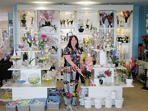 Pictured arranging the new artificial flowers selection now available in Home Gallery, above Born in Newtownsmith, is Patrica Rock, Roscam.