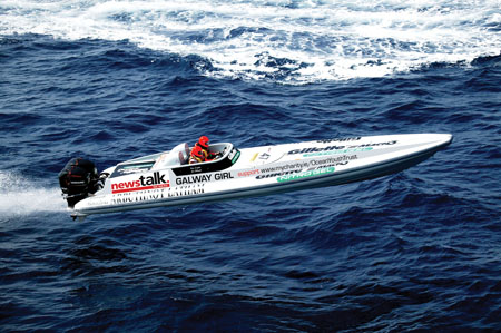 Enda's boat — One of the men behind the Galway Volvo stopover, Galway's Enda O'Coineen, is back on the water this weekend, having swapped sail for a something inordinately faster. O'Coineen is part of the two-man team racing the Kilcullen Galway Flyer in this weekend's Powerboat Festival to raise money for the Ocean Youth Trust Charity. Originally designed by Fabio Buzzi for the Italian police, the Kilcullen Galway Flyer is 36 feet long and has a range of 200+ miles.  Powered by twin 300 horse power works Mercury engines, the boat is capable of almost 100 miles an hour on flat water. Interestingly, the boat also has a space for a gun turret and was designed to outpace drug smugglers, according to O'Coineen.