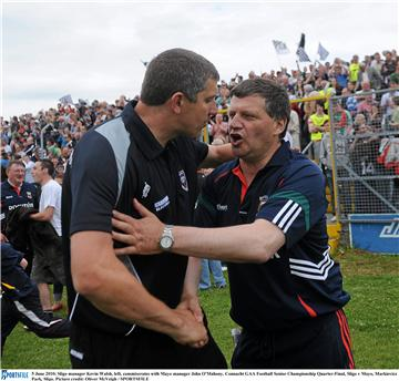 Time to go through the back door: Kevin Walsh and John O'Mahony after the game. Photo: Sportsfile