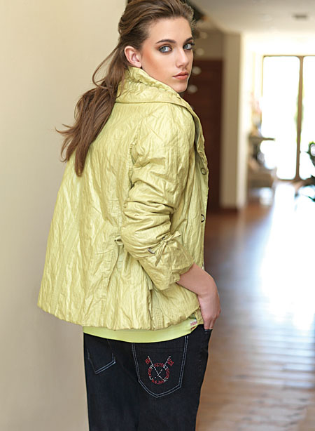 Lime green jacket with oversize collar (€140) pink and white T-shirt (€70) and black cotton denims (€80).