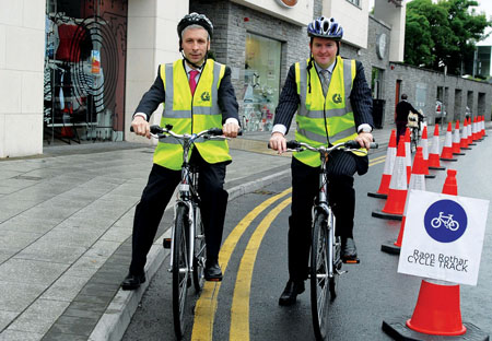 City manager Joe McGrath and Deputy Mayor Peter Keane get into the saddle at the launch of Galway's Bike Week.
