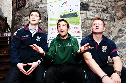 Galway sports stars line up for the World Cup in the World Cup Lounge located in the Eyre Square Centre.  Galway senior footballer Michael Meehan, Connacht rugby player Brian Tuohy and Galway senior hurler Joe Canning get in on the excitement of the first World Cup finals match in the World Cup Lounge on Friday.   Photo:  Reg Gordon