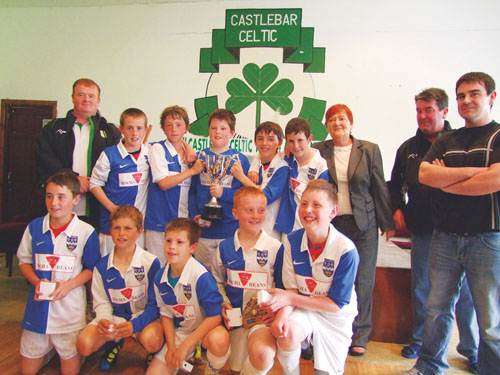 Ballina Town U12 team winners of the Inaugural Michael Whyte Memorial Cup which was played at Castlebar Celtic recently. Included in the picture are from left Greg Whyte (son), Kitty (wife), Ger and Gordon (sons).