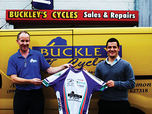 Sponsor Pat Buckley of Buckley Cycles presents the team jerseys to Karl Turley, Frank Young Memorial Cycle co-ordinator.