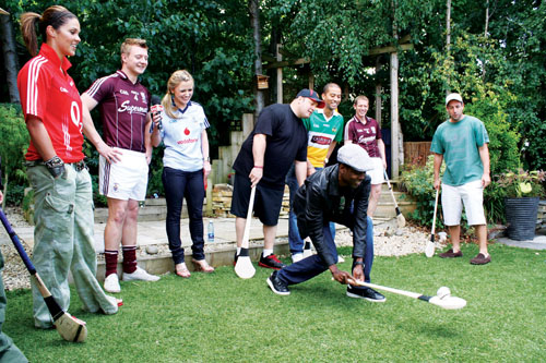 Hurling All Stars Joe and Ollie Canning look on with the TV3 Xpose team and film cast members of The Grown Ups as Chris Rock gets to grips with a sliotar and hurley. Photo: Andrew Formentini