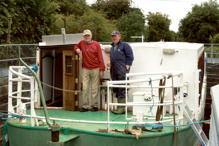 The FAS renovated Barge No 3 in receipt of a final overhaul and checks at the dry dock in Mullingar harbour. Next month it will be the first vessel to travel from the Royal Canal to the River Shannon in 55 years. Pictured is CoIm Dardis, chief executive of The Canal Amenity Group and Leo Wright aboard The Kilucan Barge