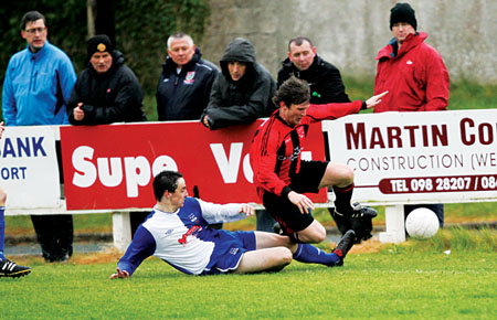 Hard tackles: Brendan Giblin (Ballina Town) puts in a tackle on Kevin Joyce (Westport United) during the sides meeting in the Super League earlier this season. Photo: Michael Donnelly