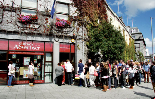The traditional Advertiser queue lives on in 2010 — the scene in Eyre Square yesterday.