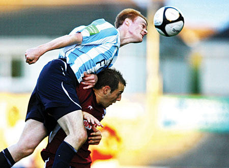 Salthill Devon captain Brian Geraghty  heads off  Galway United's Karl Sheppard to the ball in action from the FAI Ford Senior Challenge Cup at Terryland Park on Friday night.  Photo:-Mike Shaughnessy