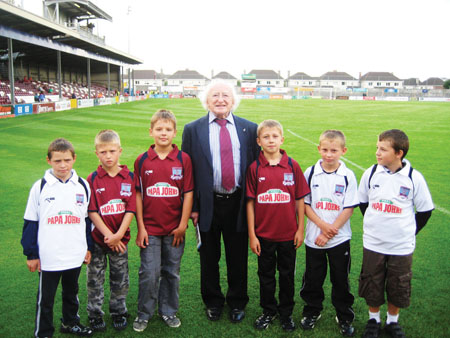 Dep Michael D Higgins with some of the Chernobyl children who visited Galway this year, at the Galway United v Dundalk match on July 25. GUFC kindly had them as mascots at the game.
