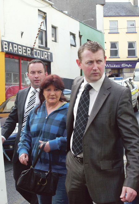 Agnes McCarthy (54) is escorted into Athlone District Court by Garda Tom Higgins (left) and Detective Sergeant Eamonn Curley, where she was arraigned on Wednesday morning for the unlawful killing of Lily Scanlon nearly two and a half years ago.