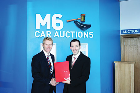 Caption: Pictured l to r Nigel Buttner, sales manager of Mapfre Asistencia, Ireland Assist, and Tom Lynskey of M6 car auctions.