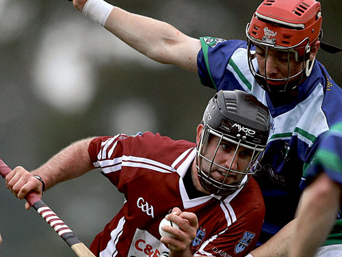 Enda Collins of Clarenbridge and Shane Moloney of Tynagh Abbey Duniry in action from the Cooper Senior Hurling Championship semi-final at Kenny Park, Athenry on Sunday.		 Photo:-Mike Shaughnessy