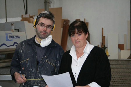 Kieran Staunton, Senior Cabinet Maker with Majelle Flately, Kitchen Designer discussing kitchen plans.