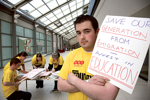 NUI Galway student union president Peter Mannion (right) and students prepare before a first of the regional protests by students today at 1.30pm in the city against possible financial cuts to third level education in the forthcoming budget.  Photo:-Mike Shaughnessy