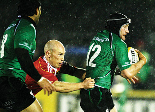 Connacht captain Keith Matthews is tackled by Munster's Peter Stringer in action from the Magners League game on Monday evening. Photo:-Mike Shaughnessy