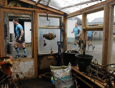 Galwegians players make their way from the dressing room to the pitch past the club's 'greenhouse' at Crowley Park, Glenina, last weekend. Picture credit: Stephen McCarthy / Sportsfile