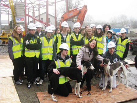 Students of the Jes gathered 'on-site' before mid-term, to announce the 'Jes Night at the Dogs' event. Pictured cheering on the winners are a transition year group, with principal Mary Joyce, and dog-handlers Féilim MacEoin with Woodpecker and Gary Farrell with Harmony Hill.