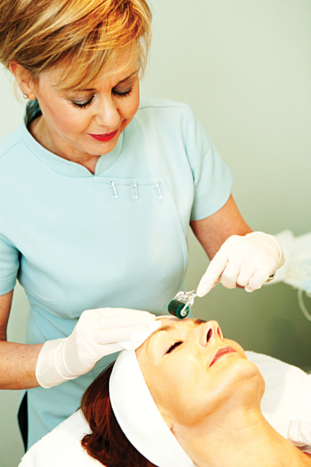 Beauty therapist, Angela Silke demonstrates derma rollering by Medik8 at her local salon. Photo: Martina Regan.