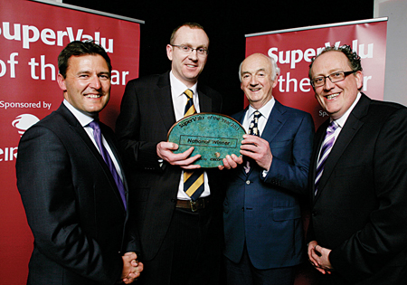 Pictured at the presentation from left to right, Clive Ryan, general manager, eircom Business, Michael and Ger McInerney, Martin Kelleher, managing director, SuperValu