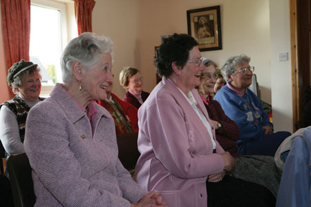 Some listeners enjoying storytelling at a past Bealtaine event.
