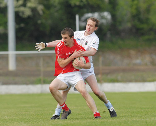 John McGuire, Caulry is tackled by Moate's Stephen Byrne during last weekend's Intermediate Championship encounter. Photo: johnobrienimages.com