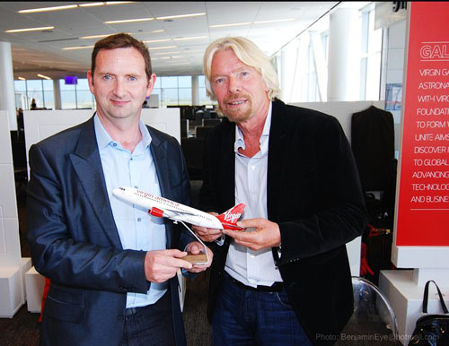 PJ King accepting the replica of the new Airbus, named Myles from Connemara after his late father, from Richard Branson last month.