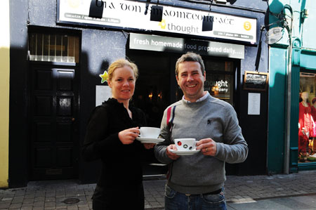 Gearóidín Ní Ghioballáin, Gaillimh le Gaeilge and Ken Walsh, Food 4 Thought enjoying a cup of tea outside the well known café on Lower Abbeygate Street. Bilingual signage is in use both inside and outside the café.