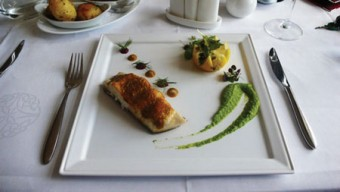 Wild halibut roasted in Sicilian butter with a green pea and watercress purée.