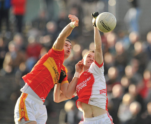 Starting all over again: Castlebar Mitchels, Barry Moran, and Ballintubber's Cathal Hallinan go high for the ball in last year's county final. The club championship kicks off this weekend all over the county. Photo: Sportsfile.