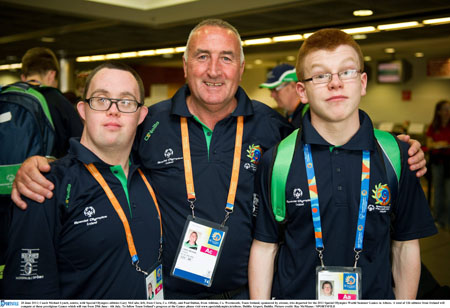 Coach Michael Lynch, centre, with Special Olympics athletes Gary McCabe, left, from Clara, Co Offaly, and Paul Dalton, from Athlone, Co  Westmeath who departed for the 2011 Special Olympics World Summer Games in Athens. Photo: SPORTSFILE