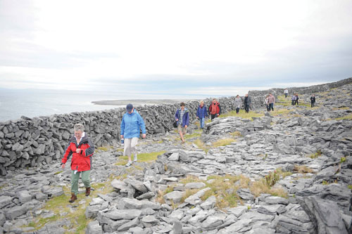 Druid director Garry Hynes leads a walk to Synge's Chair on the island of Inis Meáin. Druid were on the island to present the first performance of The Cripple of Inishmaan by Martin McDonagh on June 26, 2011. Photo by Robert Day.