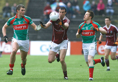 Under pressure:  Galway's Joe Bergin is chased down by Mayo's Aidan O'Shea and Donal Vaughan in the Connacht Senior Football championship semi-final at McHale Park, Castlebar, on Sunday.