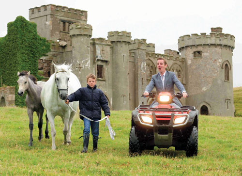 Let's get the flock out of here — Ryan Tubridy on a quad bike with Henry O Toole in the grounds of Clifden Castle last year. The quadbike will be handy for Mr Tubridy as the Freedom allegedly carries the right to graze one's sheep throughout Connemara.