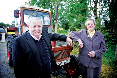 Pa and Bridget Crehan with their 1973 vintage Universal tractor at a photocall to announce details of the Mountbellew Vintage Rally which takes place at Mountbellew Mart on Saturday and Sunday. Photo:-Mike Shaughnessy