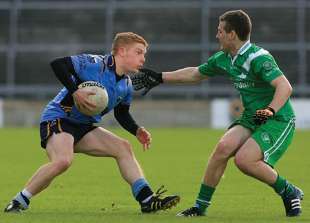 Salthill Knocknacarra's flyer at corner forward, Gearoid O'Leidhinn, evades Moycullen's Greg Bohan in  the Senior Football Championship quarter-final at Pearse Stadium on Sunday. Photo:-Mike Shaughnessy
