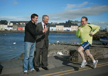 On your marks: Cllr Michael Crowe warms up for the Galway City Bay Half marathon which takes place on Saturday in aid of Cancer Care West watched by Ciarán Hayes, director of services, Galway City Council and race director, Ray O'Connor.  Photo:-Mike Shaughnessy