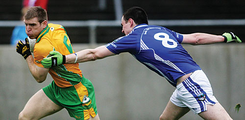 Kieran McGrath of Corofin escapes Milltown's Damien Brennan in action from the senior football championship game at Tuam Stadium on Sunday. Photo:-Mike Shaughnessy