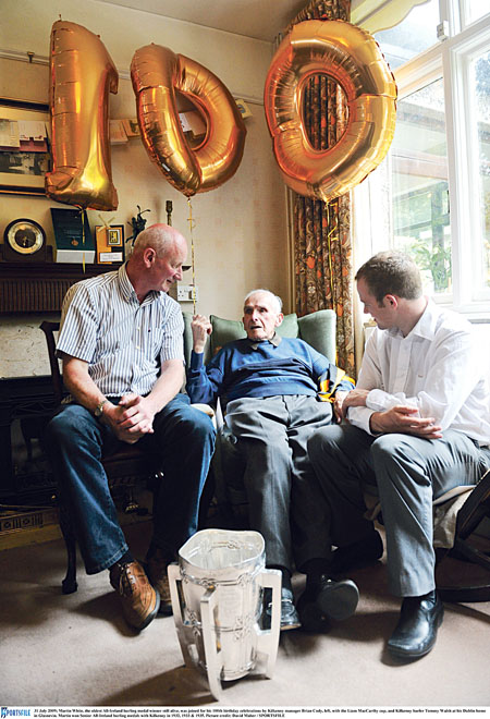 Martin White, who passed away this week, is pictured at his 100th birthday celebrations with Kilkenny manager Brian Cody, fellow Tullaroan legend Tommy Walsh, and the Liam McCarthy Cup at his Dublin home in Glasnevin. Photo: David Maher/Sportsfile.