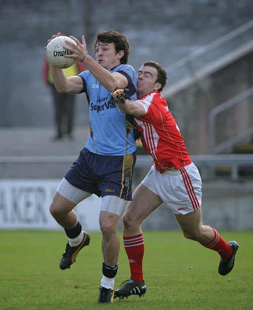 Salthill Knocknacarra sub Sean Armstrong, who saved Salthill blushes on Sunday with an equaliser, wins the ball despite the efforts of Tuam Stars' Ian McGough in action from the senior football semi-final at Pearse Stadium on Sunday. Photo:-Mike Shaughnessy