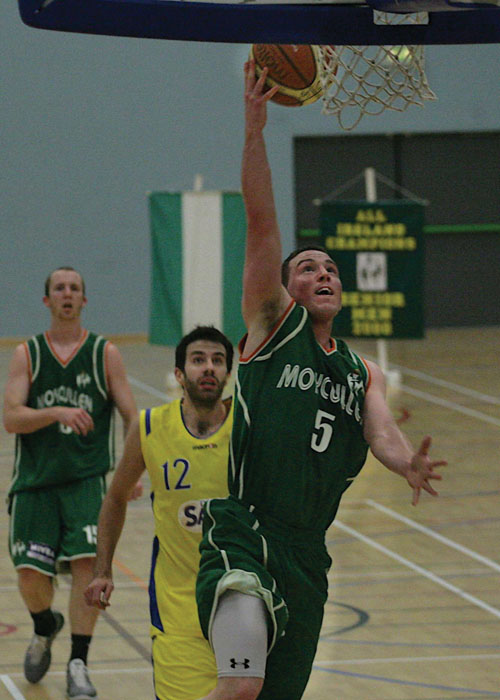Moycullen's Kevin Folan scores a basket as DCU Saints' Kevin Lacey watches on in action from the Nivea  Super League at NUIG on Saturday.  			Photo:-Mike Shaughnessy