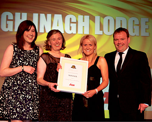 Lough Inagh's Sorcha O'Connor, Maire O'Connor and Dominic O'Morain receive the gold award from Clare McKenna, financial director of sponsor Aon, at the 23rd annual Hotel & Catering Review Gold Medal Awards.