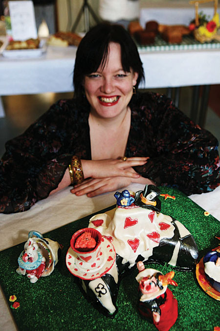 Linda Lambert with her 'The Madness of the Tea Party' novely cake.