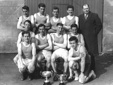 Caption: Successful Derrydonnell AC athletes cir 1958: Front row: Bernie Rohan, Eamonn Fitzpatrick. Middle row: Bernie Ruane, Willie Morris, Tommy Madden, Kevin Ryan. Back row: George Moran, John Joe Burke, Peter Michael Conneely, Mick Molloy, Dick Walsh.