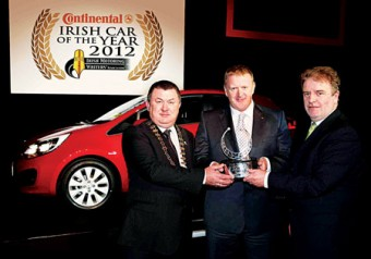 Pictured are Gerry Murphy, chairman of the IMWA; James Brooks, managing director, KIA Ireland; and Paddy Murphy, general manager of Continental Tyres.